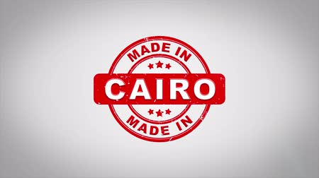 egyiptomi : Made In CAIRO Signed Stamping Text Wooden Stamp Animation. Red Ink on Clean White Paper Surface Background with Green matte Background Included. Stock mozgókép