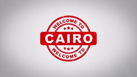 esfinge : Welcome to CAIRO Signed Stamping Text Wooden Stamp Animation. Red Ink on Clean White Paper Surface Background with Green matte Background Included.