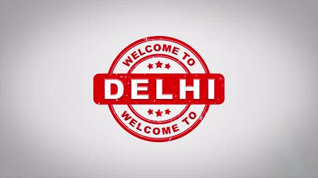 papírnictví : Welcome to DELHI Signed Stamping Text Wooden Stamp Animation. Red Ink on Clean White Paper Surface Background with Green matte Background Included.