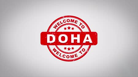 papírnictví : Welcome to DOHA Signed Stamping Text Wooden Stamp Animation. Red Ink on Clean White Paper Surface Background with Green matte Background Included.