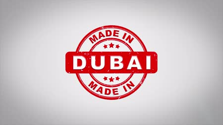 papírnictví : Made In DUBAI Signed Stamping Text Wooden Stamp Animation. Red Ink on Clean White Paper Surface Background with Green matte Background Included. Dostupné videozáznamy