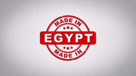 papírnictví : Made In EGYPT Signed Stamping Text Wooden Stamp Animation. Red Ink on Clean White Paper Surface Background with Green matte Background Included.