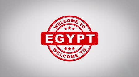 madalya : Welcome to EGYPT Signed Stamping Text Wooden Stamp Animation. Red Ink on Clean White Paper Surface Background with Green matte Background Included.