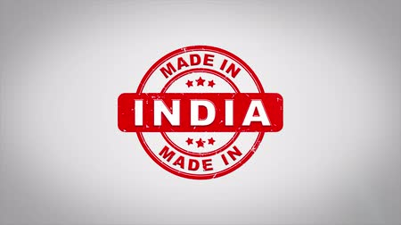 papírnictví : Made In INDIA Signed Stamping Text Wooden Stamp Animation. Red Ink on Clean White Paper Surface Background with Green matte Background Included.