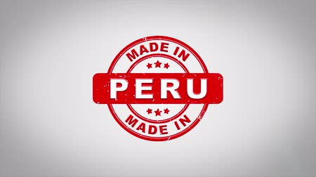 papírnictví : Made In PERU Signed Stamping Text Wooden Stamp Animation. Red Ink on Clean White Paper Surface Background with Green matte Background Included.