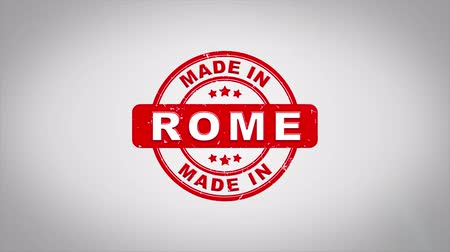 rubber stamp : Made In ROME Signed Stamping Text Wooden Stamp Animation. Red Ink on Clean White Paper Surface Background with Green matte Background Included.