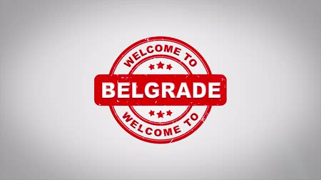 rubber stamp : Welcome to BELGRADE Signed Stamping Text Wooden Stamp Animation. Red Ink on Clean White Paper Surface Background with Green matte Background Included.