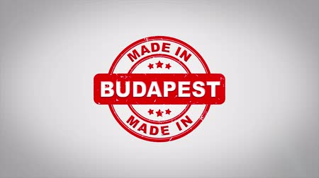 papírnictví : Made In BUDAPEST Signed Stamping Text Wooden Stamp Animation. Red Ink on Clean White Paper Surface Background with Green matte Background Included. Dostupné videozáznamy