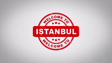 isztambul : Welcome to ISTANBUL Signed Stamping Text Wooden Stamp Animation. Red Ink on Clean White Paper Surface Background with Green matte Background Included. Stock mozgókép