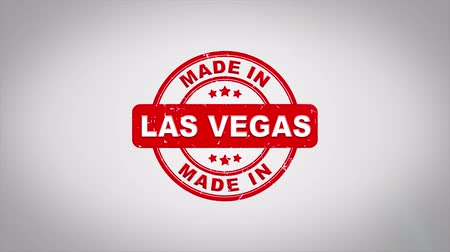 papírnictví : Made In LAS VEGAS Signed Stamping Text Wooden Stamp Animation. Red Ink on Clean White Paper Surface Background with Green matte Background Included.