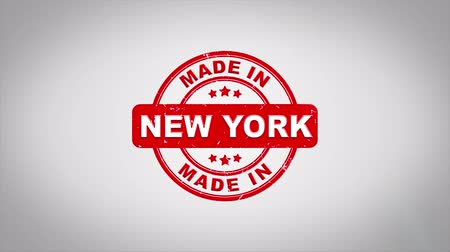 süspansiyon : Made In NEW YORK Signed Stamping Text Wooden Stamp Animation. Red Ink on Clean White Paper Surface Background with Green matte Background Included. Stok Video