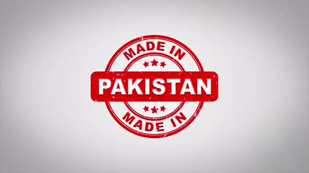papírnictví : Made In PAKISTAN Signed Stamping Text Wooden Stamp Animation. Red Ink on Clean White Paper Surface Background with Green matte Background Included. Dostupné videozáznamy