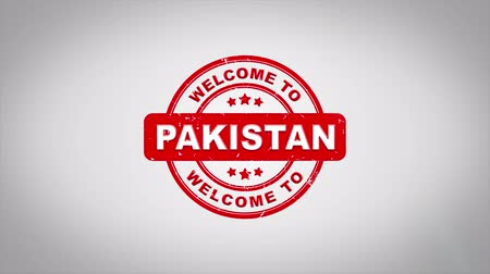 paquistão : Welcome to PAKISTAN Signed Stamping Text Wooden Stamp Animation. Red Ink on Clean White Paper Surface Background with Green matte Background Included.