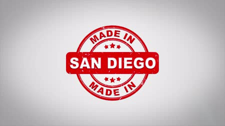construído : Made In SAN DIEGO Signed Stamping Text Wooden Stamp Animation. Red Ink on Clean White Paper Surface Background with Green matte Background Included. Stock Footage