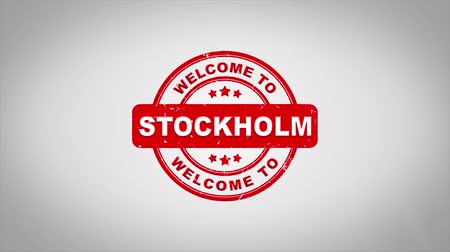 имитация : Welcome to STOCKHOLM Signed Stamping Text Wooden Stamp Animation. Red Ink on Clean White Paper Surface Background with Green matte Background Included. Стоковые видеозаписи