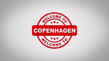 danimarka : Welcome to COPENHAGEN Signed Stamping Text Wooden Stamp Animation. Red Ink on Clean White Paper Surface Background with Green matte Background Included. Stok Video