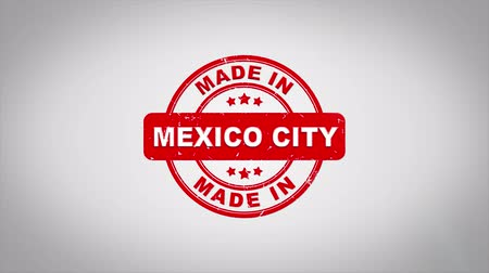 papírnictví : Made In MEXICO CITY Signed Stamping Text Wooden Stamp Animation. Red Ink on Clean White Paper Surface Background with Green matte Background Included.