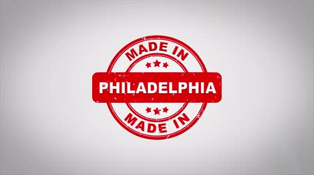 applying : Made In PHILADELPHIA Signed Stamping Text Wooden Stamp Animation. Red Ink on Clean White Paper Surface Background with Green matte Background Included. Stock Footage