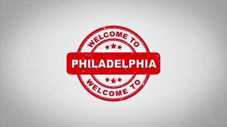 köszönt : Welcome to PHILADELPHIA Signed Stamping Text Wooden Stamp Animation. Red Ink on Clean White Paper Surface Background with Green matte Background Included.