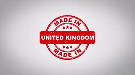 papírnictví : Made In UNITED KINGDOM Signed Stamping Text Wooden Stamp Animation. Red Ink on Clean White Paper Surface Background with Green matte Background Included.