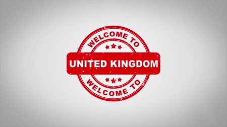 papírnictví : Welcome to UNITED KINGDOM Signed Stamping Text Wooden Stamp Animation. Red Ink on Clean White Paper Surface Background with Green matte Background Included.