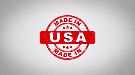 rubber stamp : Made In USA Signed Stamping Text Wooden Stamp Animation. Red Ink on Clean White Paper Surface Background with Green matte Background Included.