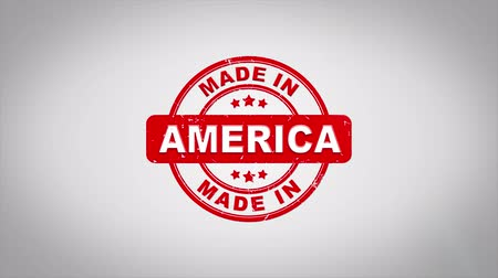 applying : Made In America Signed Stamping Text Wooden Stamp Animation. Red Ink on Clean White Paper Surface Background with Green matte Background Included.