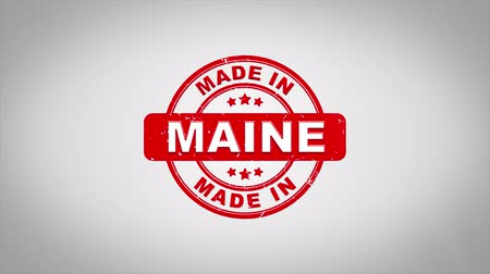 papírnictví : Made In MAINE Signed Stamping Text Wooden Stamp Animation. Red Ink on Clean White Paper Surface Background with Green matte Background Included.