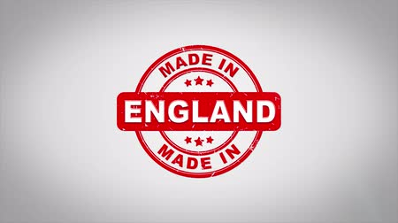 papírnictví : Made In England Signed Stamping Text Wooden Stamp Animation. Red Ink on Clean White Paper Surface Background with Green matte Background Included.