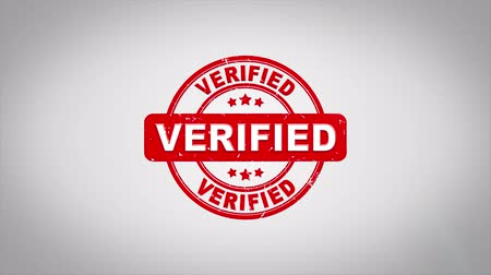 удовлетворение : Verified Signed Stamping Text Wooden Stamp Animation. Red Ink on Clean White Paper Surface Background with Green matte Background Included.