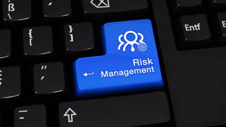 incerteza : Risk Management Rotation Motion On Blue Enter Button On Modern Computer Keyboard with Text and icon Labeled. Selected Focus Key is Pressing Animation. Business Management Concept