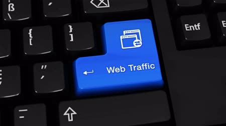 pesquisa : Web Traffic Rotation Motion On Blue Enter Button On Modern Computer Keyboard with Text and icon Labeled. Selected Focus Key is Pressing Animation. Website Development Concept