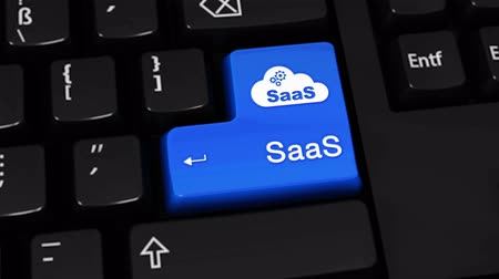 demanda : Saas Rotation Motion On Blue Enter Button On Modern Computer Keyboard with Text and icon Labeled. Selected Focus Key is Pressing Animation. software development Concept