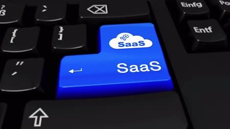 вводить : Saas Round Motion On Blue Enter Button On Modern Computer Keyboard with Text and icon Labeled. Selected Focus Key is Pressing Animation. software development Concept Стоковые видеозаписи