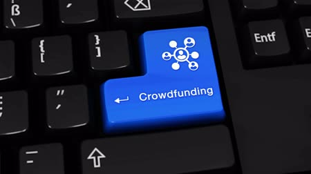 financování : Crowdfunding Rotation Motion On Blue Enter Button On Modern Computer Keyboard with Text and icon Labeled. Selected Focus Key is Pressing Animation. Social Media Concept Dostupné videozáznamy