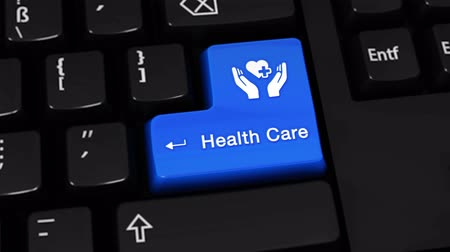 диагностировать : 104. Health Care Rotation Motion On Blue Enter Button On Modern Computer Keyboard with Text and icon Labeled. Selected Focus Key is Pressing Animation. Medical Service Concept