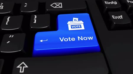 democrats : 504. Vote Now Round Motion On Blue Enter Button On Modern Computer Keyboard with Text and icon Labeled. Selected Focus Key is Pressing Animation. Stock Footage
