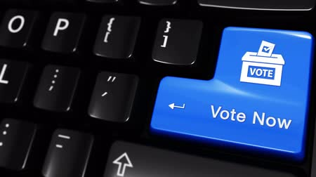 election campaign : Vote Now Moving Motion On Blue Enter Button On Modern Computer Keyboard with Text and icon Labeled. Selected Focus Key is Pressing Animation. Stock Footage