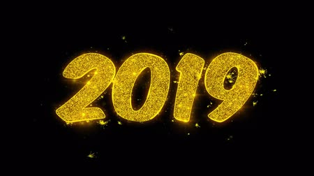 kalendarz : Happy New Year 2019 Typography Written with Golden Particles Sparks Fireworks Display 4K. Greeting card, Celebration, Party Invitation, calendar, Gift, Events, Message, Holiday, Wishes Festival . Wideo