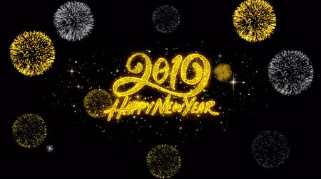 firework display : Happy New Year 2019 golden greeting Text Appearance blinking particles with golden fireworks Display 4K for Greeting card, Celebration, Invitation, calendar, Gift, Events, Message, Holiday, Wishes .