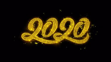 kalendarz : Happy New Year 2020 Typography Written with Golden Particles Sparks Fireworks Display 4K. Greeting card, Celebration, Party Invitation, calendar, Gift, Events, Message, Holiday, Wishes Festival .