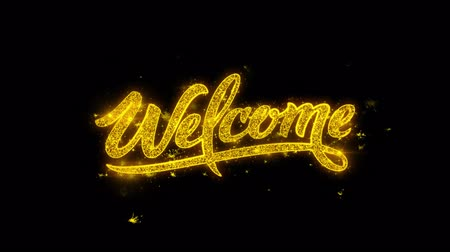 написанный : Welcome Typography Written with Golden Particles Sparks Fireworks Display 4K. Greeting card, Celebration, Party Invitation, calendar, Gift, Events, Message, Holiday, Wishes Festival