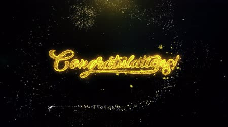 övgü : Congratulations Written Gold Glitter Particles Spark Exploding Fireworks Display 4K . Greeting card, Celebration, Party Invitation, calendar, Gift, Events, Message, Holiday, Wishes Festival