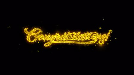 градация : Congratulations Typography Written with Golden Particles Sparks Fireworks Display 4K. Greeting card, Celebration, Party Invitation, calendar, Gift, Events, Message, Holiday, Wishes Festival