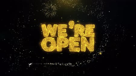 привлекать : We Are Open Written Gold Glitter Particles Spark Exploding Fireworks Display 4K . Greeting card, Celebration, Party Invitation, calendar, Gift, Events, Message, Holiday, Wishes Festival .