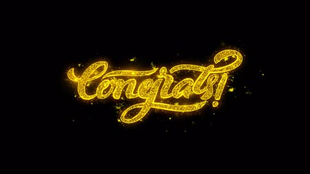 フレーズ : Congrats Typography Written with Golden Particles Sparks Fireworks Display 4K. Greeting card, Celebration, Party Invitation, calendar, Gift, Events, Message, Holiday, Wishes Festival 動画素材