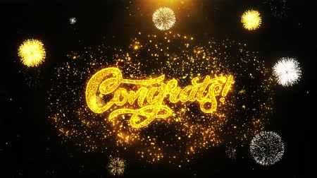 övgü : Congrats Text Sparks Particles Reveal from Golden Firework Display explosion 4K. Greeting card, Celebration, Party Invitation, calendar, Gift, Events, Message, Holiday, Wishes Festival . Stok Video