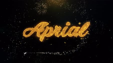 mángorlógép : April Written Gold Glitter Particles Spark Exploding Fireworks Display 4K . Greeting card, Celebration, Party Invitation, calendar, Gift, Events, Message, Holiday, Wishes Festival Stock mozgókép