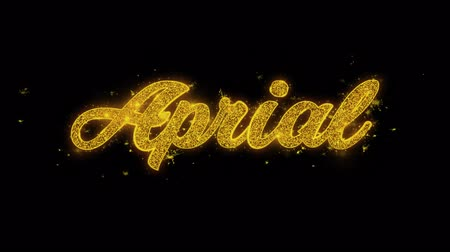 lehet : April Typography Written with Golden Particles Sparks Fireworks Display 4K. Greeting card, Celebration, Party Invitation, calendar, Gift, Events, Message, Holiday, Wishes Festival