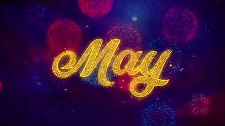 каландр : May Greeting Text with Particles and Sparks Colored Bokeh Fireworks Display 4K. for Greeting card, Celebration, Party Invitation, calendar, Gift, Events, Message, Holiday, Wishes . Стоковые видеозаписи
